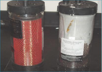 Two containers showing by-products for the silver recovery program.