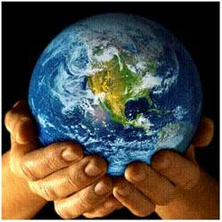 Hands holding planet earth.
